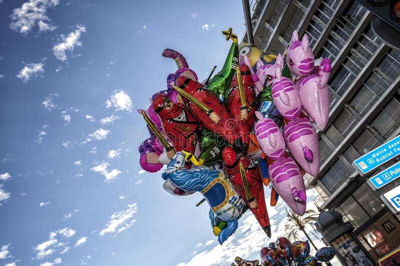 Colorful bunch of flying balloons during Nice carnival time royalty free stock photography