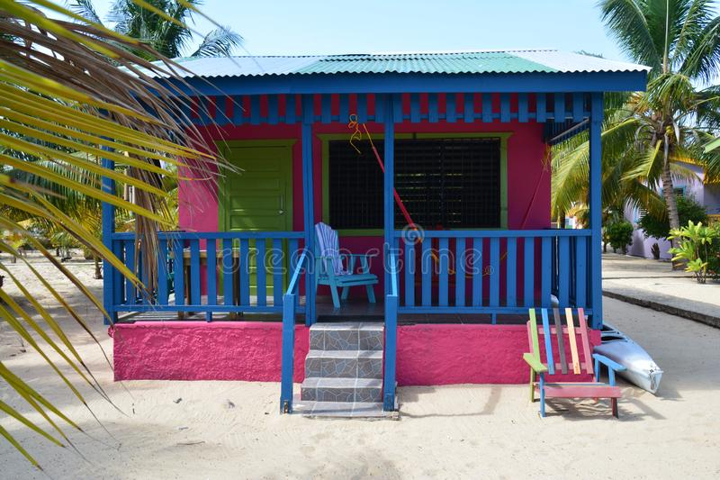 Colorful bungalows on Placencia Beach Belize stock images