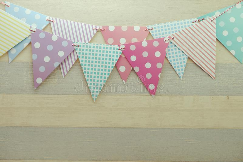 Colorful Bunting hanging with space copy on wooden background stock photography