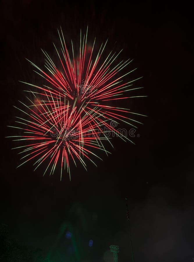 Fireworks burst on a black sky royalty free stock photography