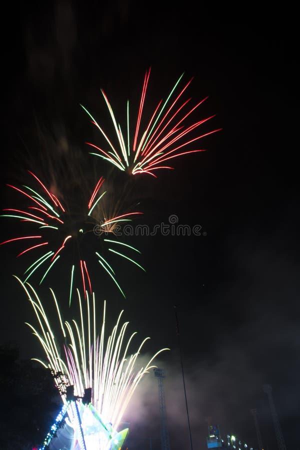 Fireworks burst on a black sky royalty free stock photo