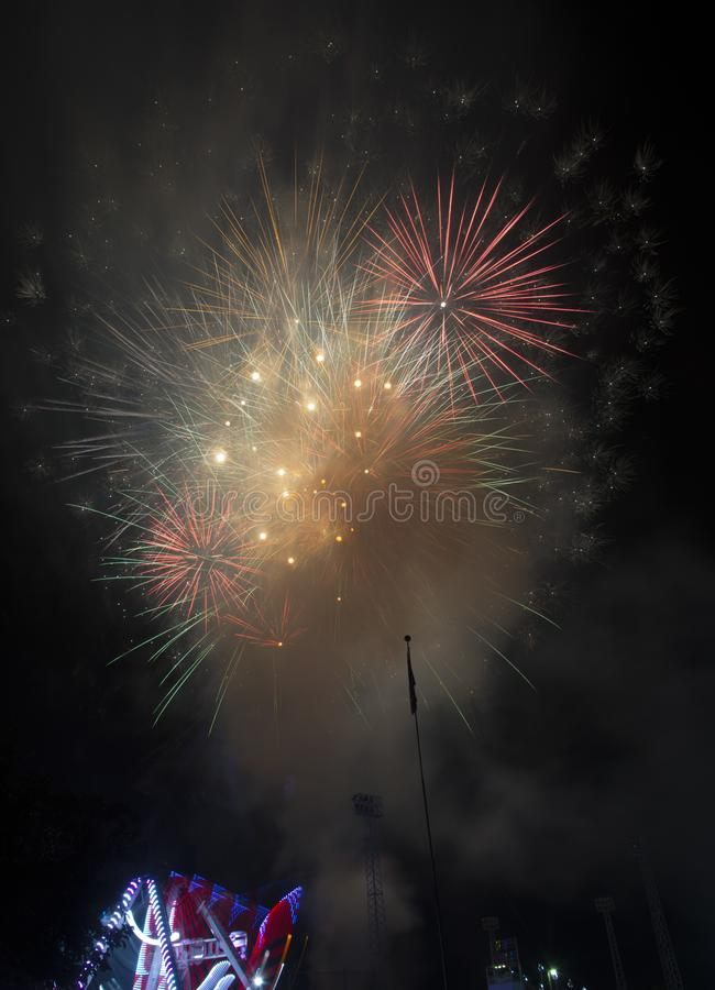 Fireworks burst on a black sky stock images