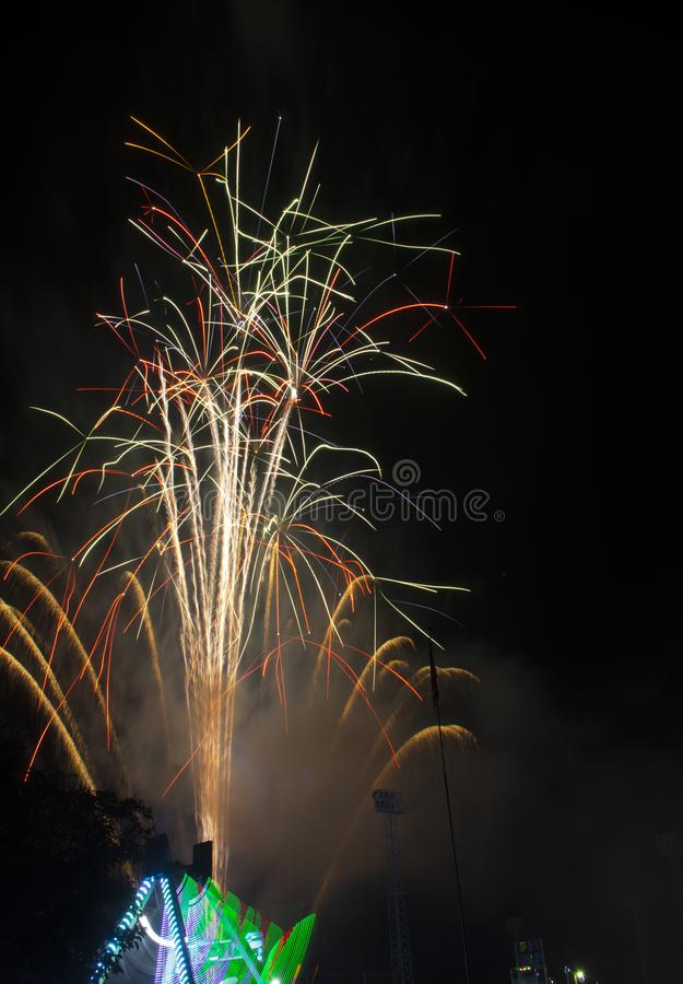 Fireworks burst on a black sky royalty free stock image