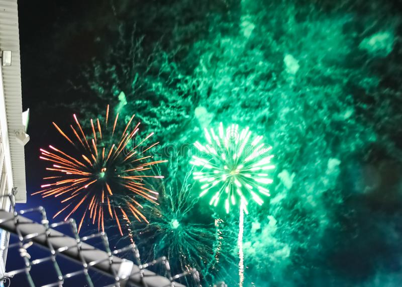 Colorful burst of fireworks and smoke at football game stock photography