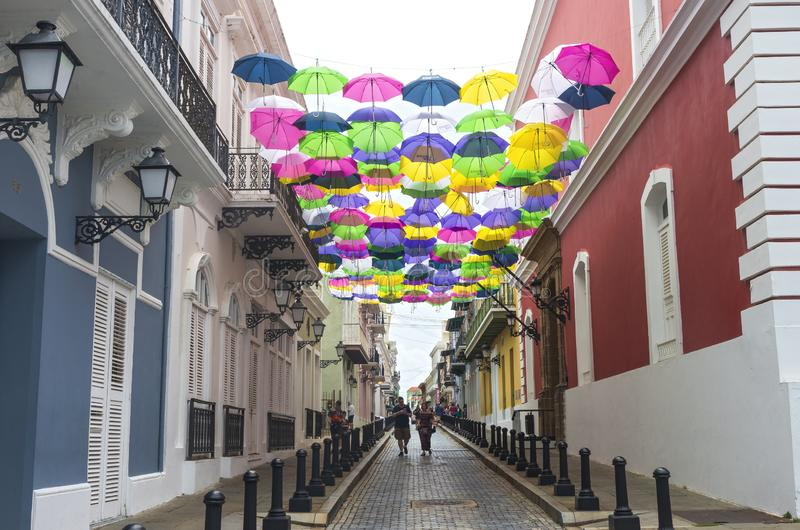 Colorful and Busy Streets of Old San Juan. San Juan, PUERTO RICO - August 4, 2018: Shoppers stroll through the cobblestone streets of Old San Juan. It is the stock image
