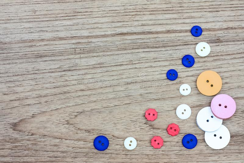 Colorful buttons on wood background. Clasper close up with text space. Colorful buttons on wood background. Clasper close up with text space royalty free stock images