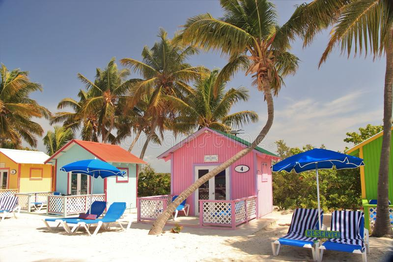 Colorful cabanas and lounge chairs on the beach in Princess Cays royalty free stock image