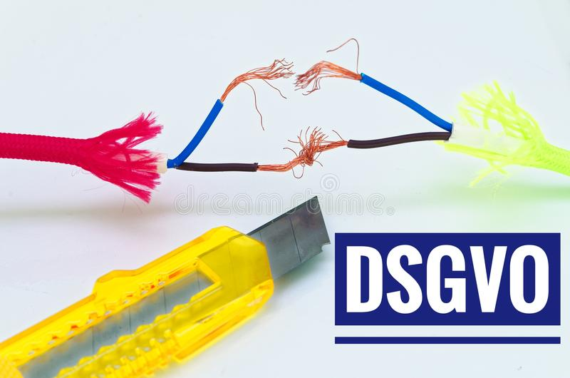 Colorful cables that were patched separately and makeshift and a craft knife with inscription in German dsgvo in English gdpr data. Protection regulation royalty free stock photo