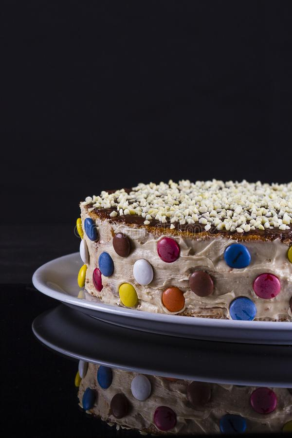 Colorful cake with almond stock image