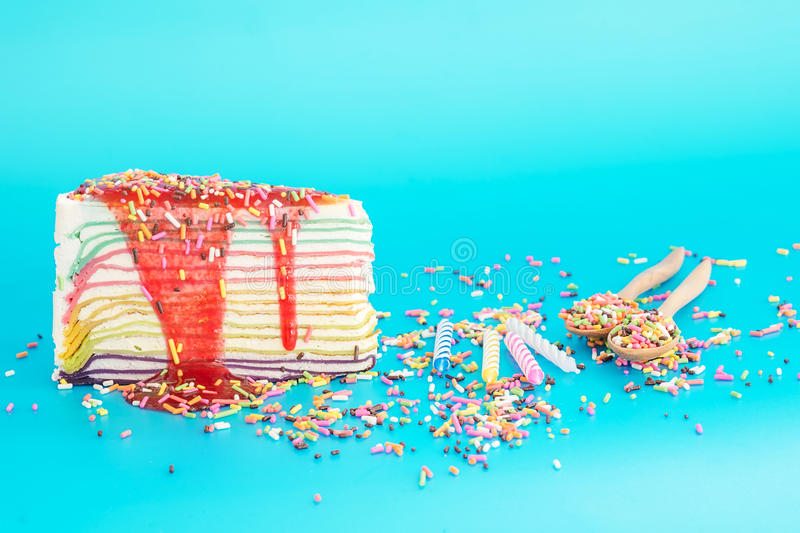 Colorful cake, candle and sweet candies spreading pastry. Decoration. prepared for party or birthday stock photos