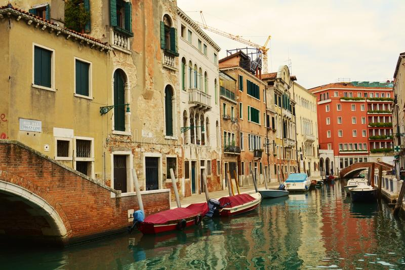 Colorful canal and boats, Venice, Italy stock photos