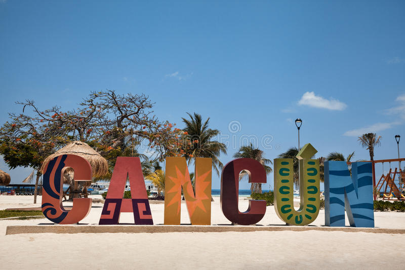 Colorful Cancun sign at the sandy beach of Mexico royalty free stock image