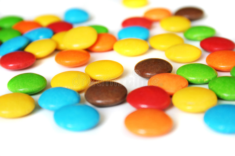 Colorful candies. On white background royalty free stock photography