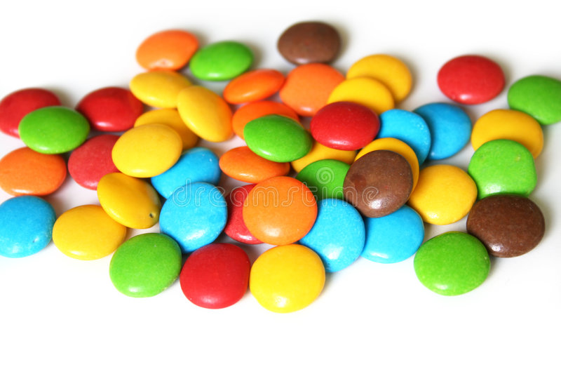 Colorful candies. On white background stock image