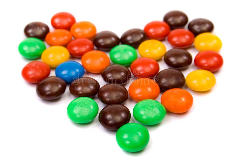 Colorful candies heart royalty free stock photography