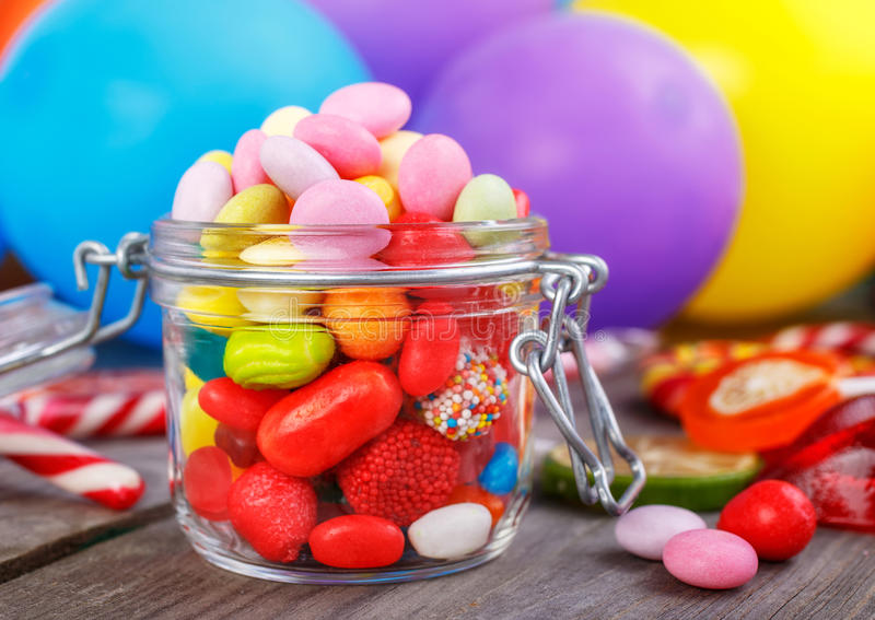 Colorful candies in jar royalty free stock photos
