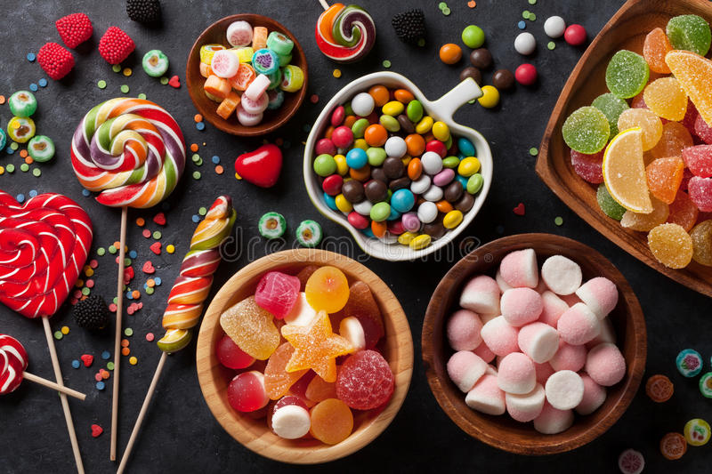 Colorful candies, jelly and marmalade. On stone background. Top view stock image