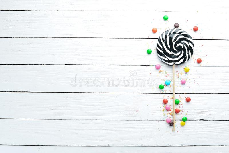 Colorful candies, jelly and marmalade on a white wooden background. Sweets. stock photos