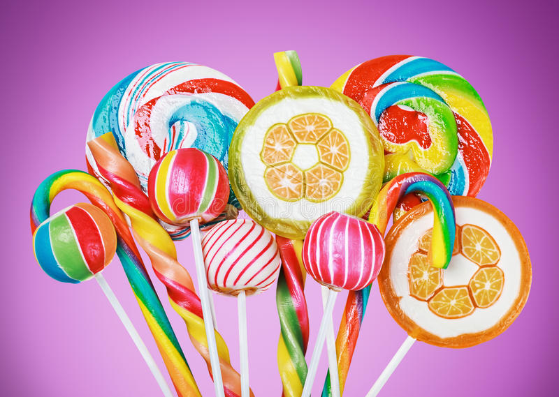 Colorful candies and lollipop stock images
