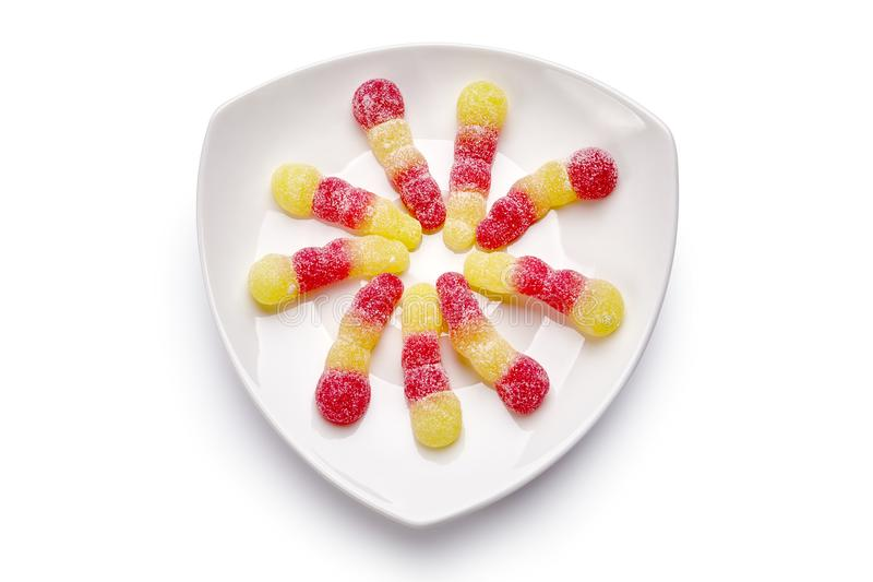 Colorful candies on the plate royalty free stock image