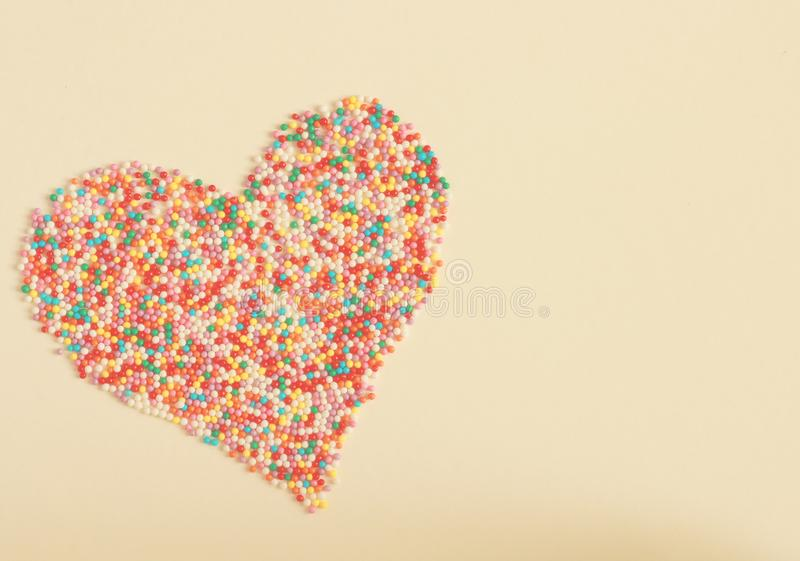 Colorful candies shaping a heart stock photos