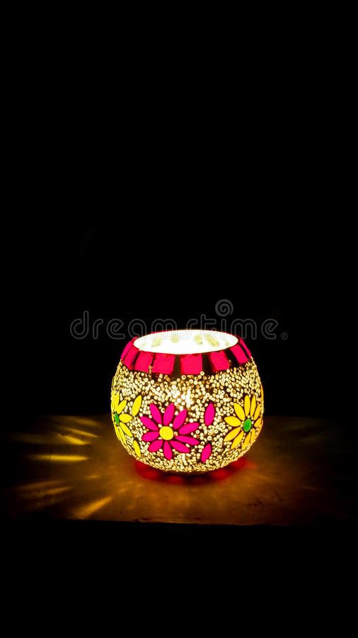 Colorful Candle Votive. Illuminated at the Eve of Diwali stock photo