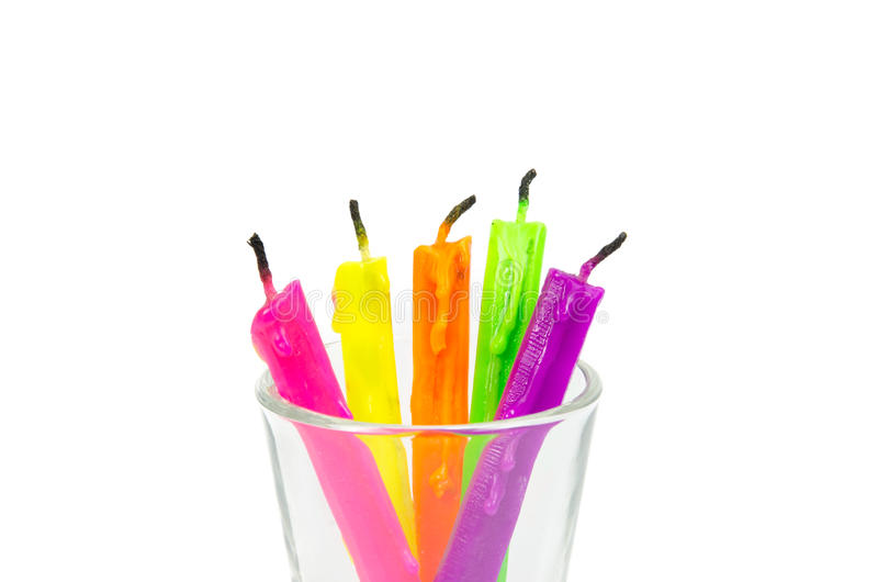 Colorful candles isolated. On white royalty free stock image