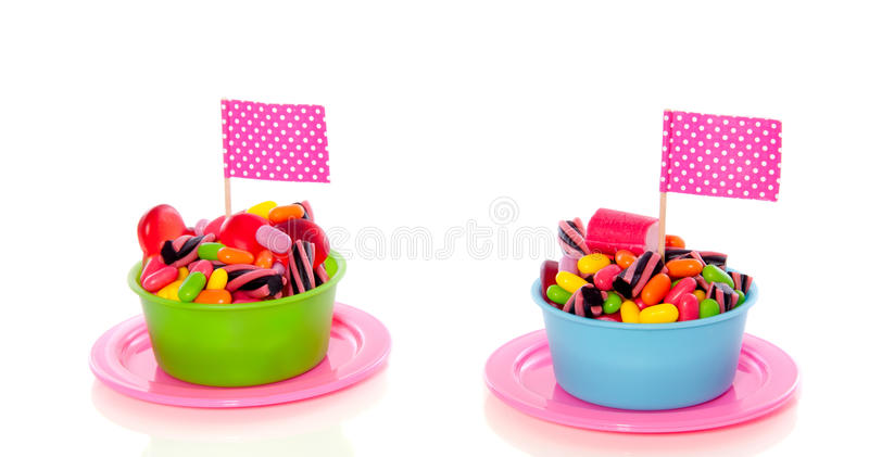 Colorful candy in cups. On a plate with a flag isolated over white royalty free stock image