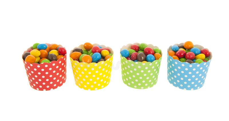 Colorful candy in cups stock photos