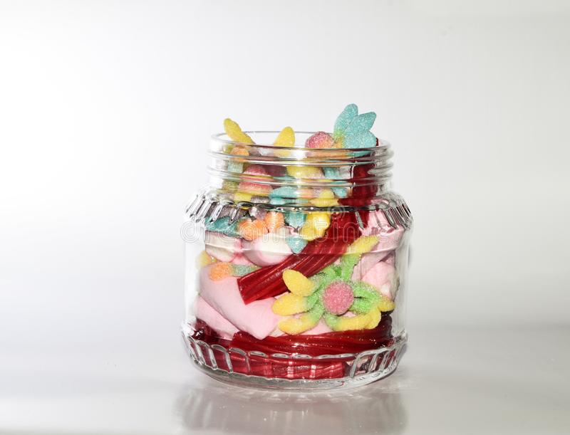 Glass jar with candies stock image