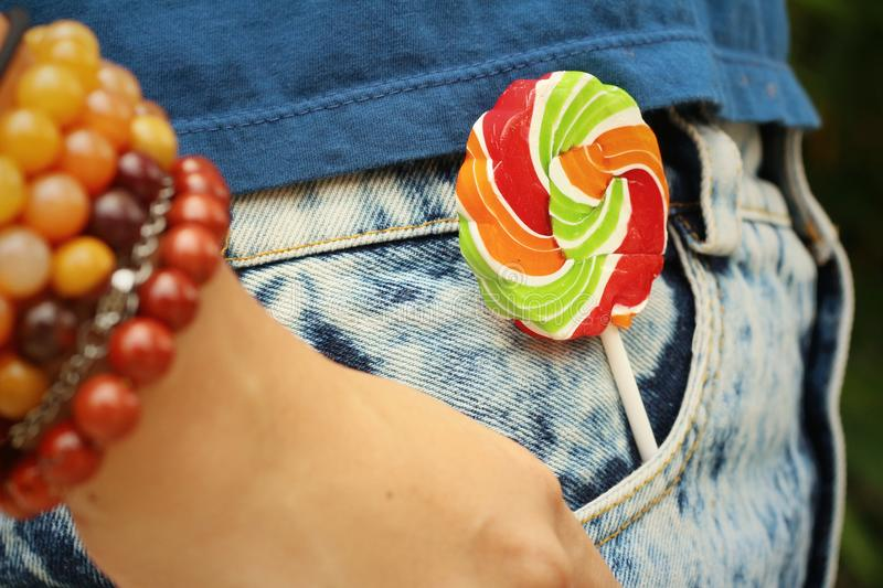 Colorful of candy in a jeans pocket. royalty free stock photography