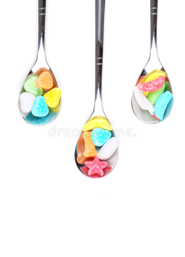 Colorful Spoons: Colorful Candy With Metal Spoons Stock Photo