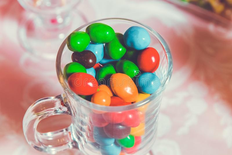Colorful candy . Multi colored sweets . Colored candy in a glass . Round chocolate is very colorful royalty free stock images