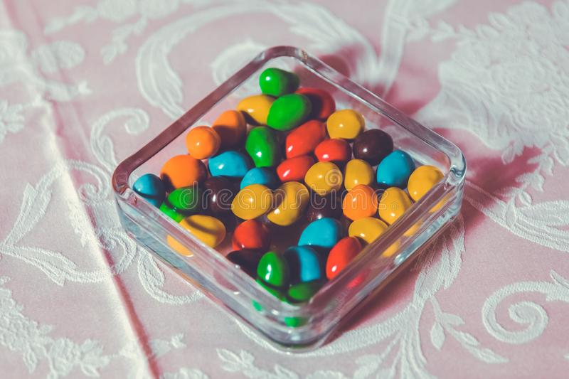 Colorful candy . Multi colored sweets . Colored candy in a glass . Round chocolate is very colorful royalty free stock photo