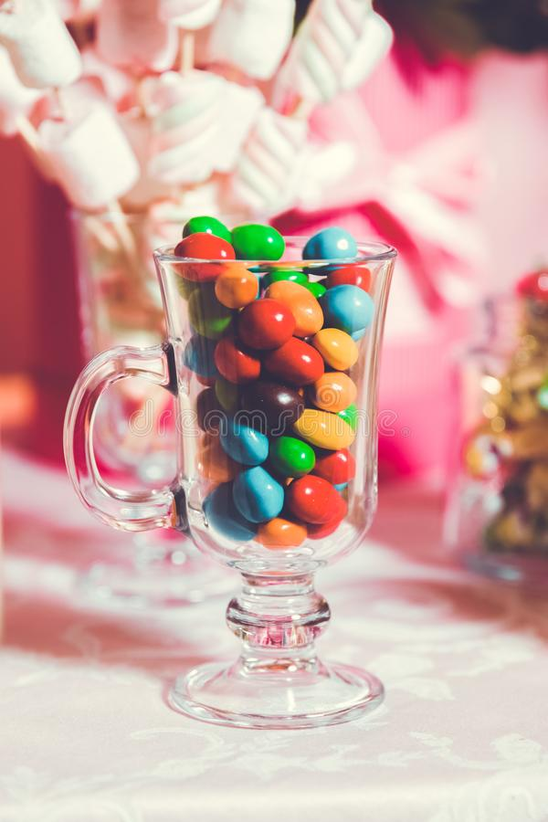 Colorful candy . Multi colored sweets . Colored candy in a glass . Round chocolate is very colorful stock photo