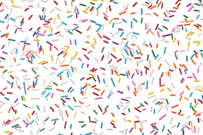 Colorful candy sprinkles isolated on white. Background royalty free stock photography