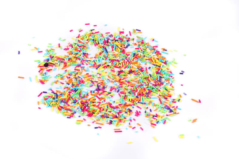 Colorful candy sprinkles. On the white background stock photos