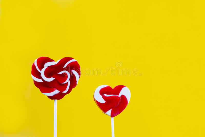 Colorful candy stick, heart shape royalty free stock photo