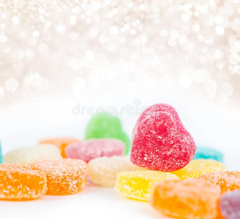 Colorful candys on white with beautiful light royalty free stock photography