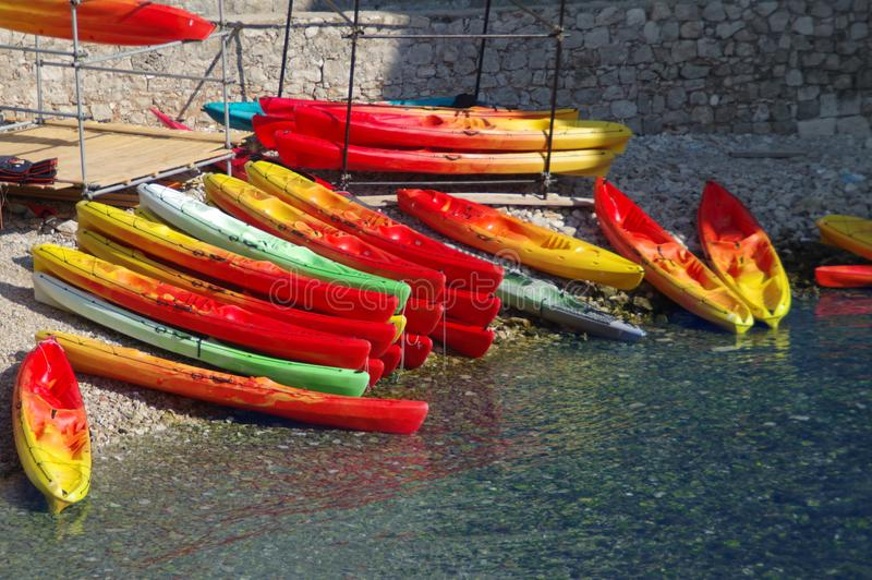Colorful canoes. On water. Red and yellow kayaks ready for summer activities and recreation stock photo
