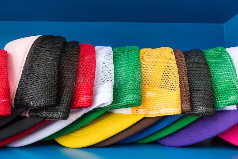 Colorful cap on blue shelf background. Fashion baseball or hiphop hat. Colorful cap on blue shelf background. Fashion baseball or hat royalty free stock images