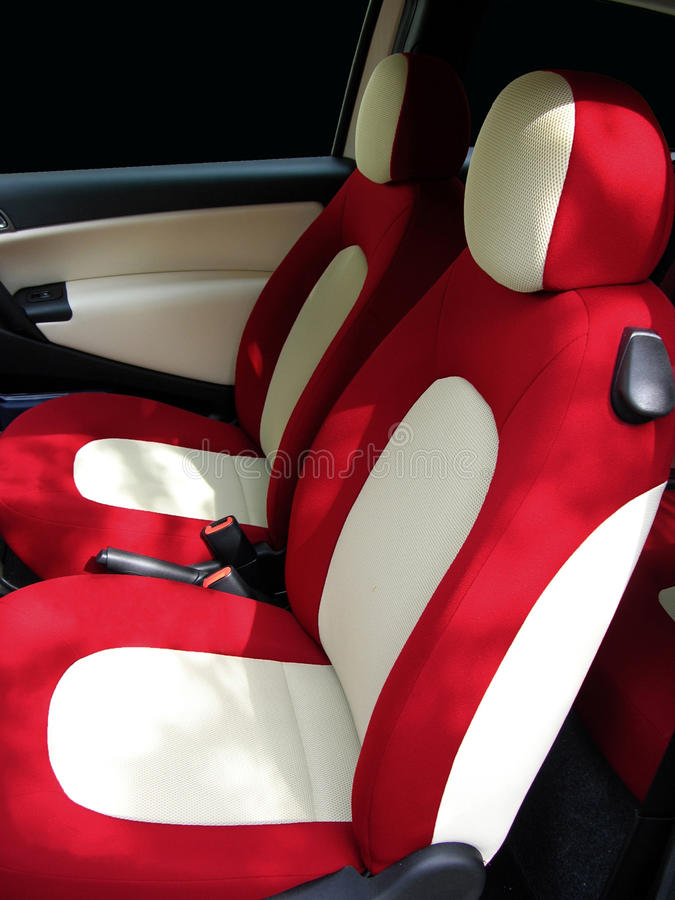 Colorful car seats. Red and cream car seats from a taylor made vehicle royalty free stock photos