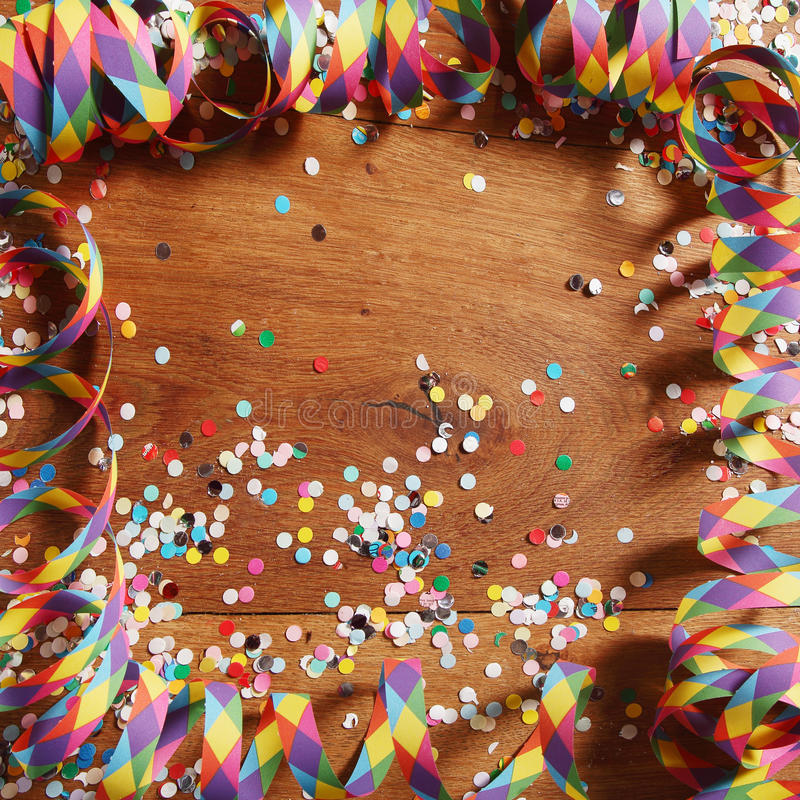 Colorful carnival frame of streamers and confetti stock images