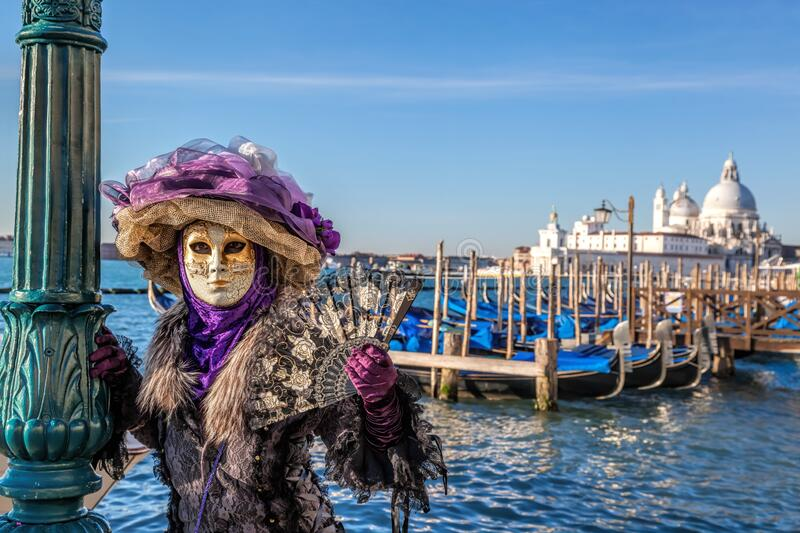Colorful carnival masks at a traditional festival in famous  Venice, Italy royalty free stock image