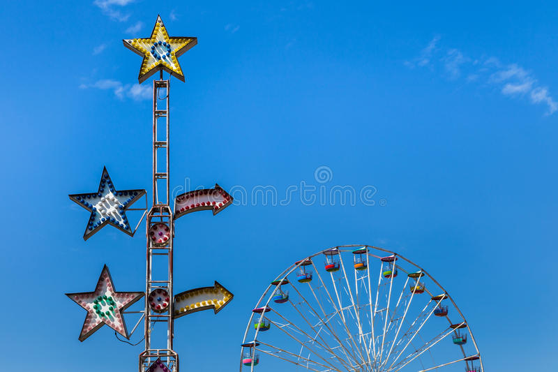 Colorful carnival ride light bulbs with ferris wheel royalty free stock photography