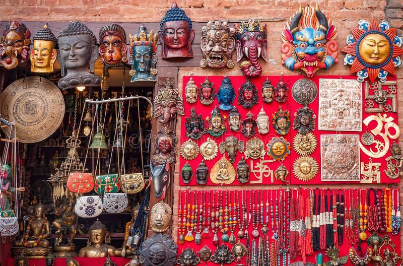 Colorful carved wooden masks and handicrafts on the traditional market in Thamel District of Kathmandu, Nepal royalty free stock photography