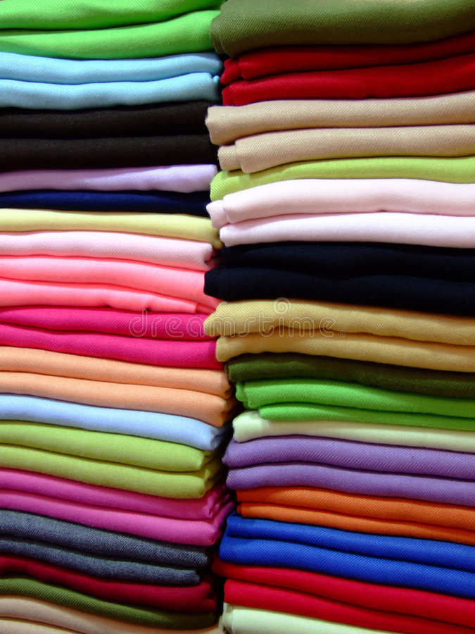 Colorful cashmere scarves. Variety of cashmere scarves in a pile royalty free stock photos