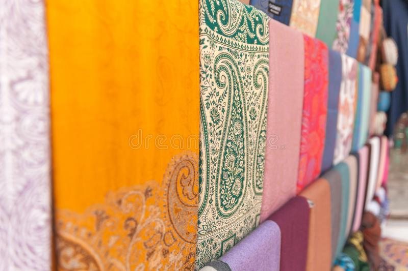 Colorful cashmere scarves at arabic traditional market, UAE stock image