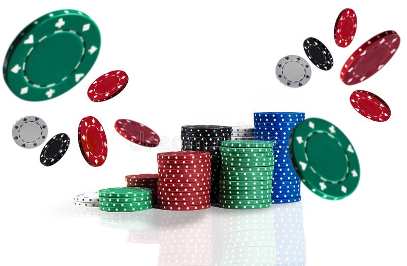 Colorful chips in piles are flying apart, isolated on white background. Close-up photo. Gambling entertainment. Colorful casino chips in piles are flying apart stock photography