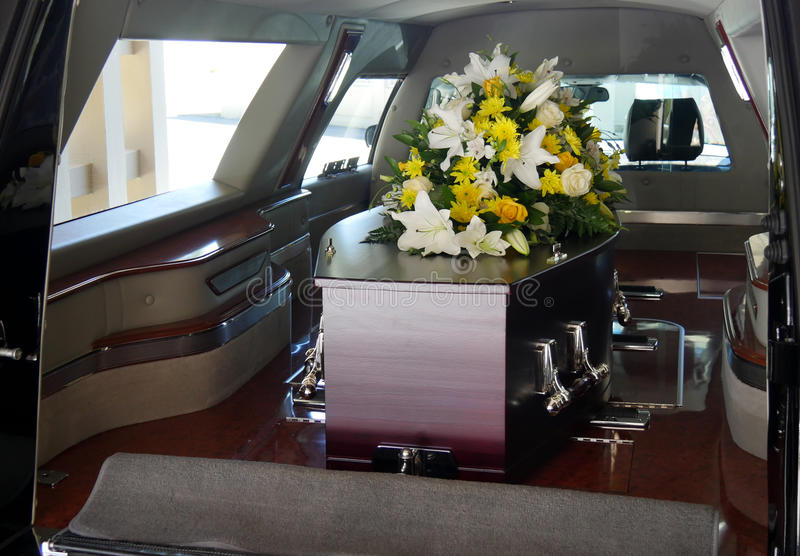A colorful casket in a hearse or church before funeral. Closeup shot of a colorful casket in a hearse or church before funeral stock photography